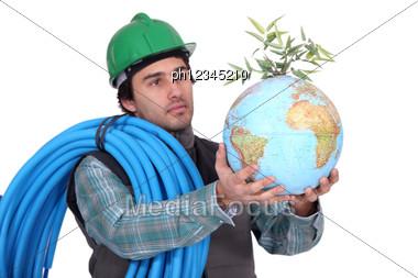 Plumber Holding Globe Stock Photo