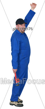 Plumber In Boiler Suit Holding Wrench Stock Photo