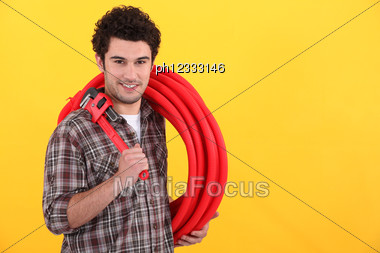 Plumber With Wrench Stock Photo
