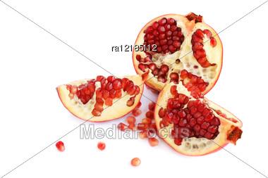 Pomegranates Isolated On White Background. Stock Photo