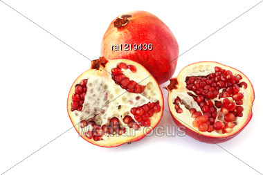 Pomegranates Isolated On White Background. Stock Photo