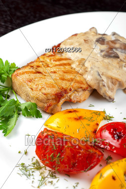 Pork Steak With Mushroom Sauce And Grilled Vegetables Stock Photo