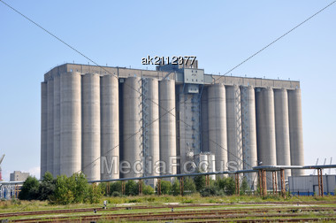 Port Granary On A Background Of The Blue Sky Stock Photo