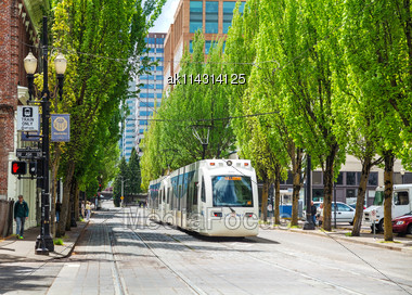 PORTLAND - MAY 4: Light Train Of The Portland Streetcar System On May 4, 2014 In Portland, Oregon. The Portland Streetcar System Opened In 2001 And Serves Areas Surrounding Downtown Portland Stock Photo