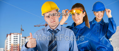 Portrait Of Architects At In Front Of Construction Site, Building And Crane. Stock Photo