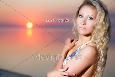 Portrait Of Attractive Blond Woman At The Sunset Stock Photo