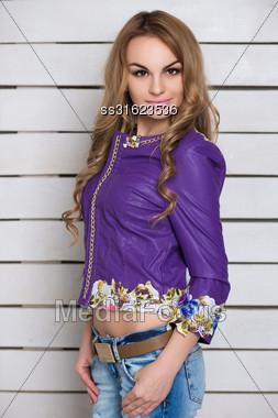 Portrait Of Attractive Blonde Wearing Purple Jacket Stock Photo