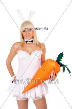 Portrait Of Attractive Sexy Young Blonde With A Carrot Stock Photo