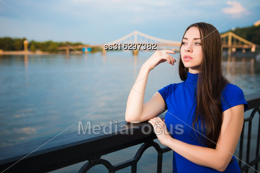 Portrait Of Attractive Young Brunette In Blue T-short Posing Near The River Stock Photo