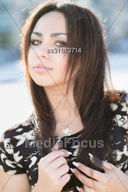 Portrait Of Attractive Young Woman Posing Outdoors Stock Photo