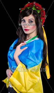 Portrait Of Attractive Young Woman Posing With Ukrainian Flag. Isolated On Black Stock Photo