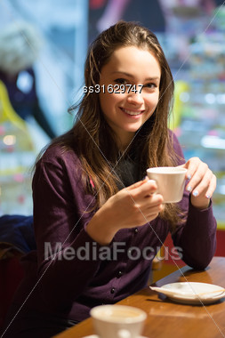 Portrait Of Beautiful Brunette Posing With A Cup Stock Photo