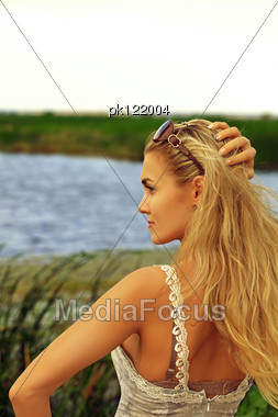 Portrait Of Beautiful Caucasian Woman On Nature, Cane Field Stock Photo