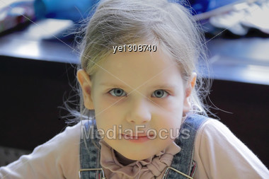 Portrait Of Beautiful Girl With Blond Hair And Blue Eyes Stock Photo