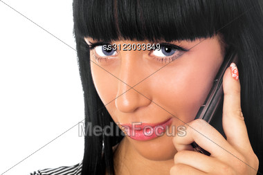 Portrait Of The Beautiful Girl Speaking On The Phone Stock Photo