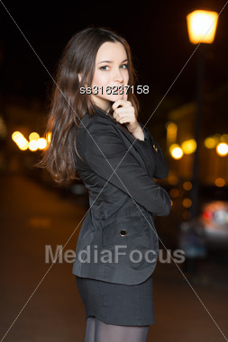 Portrait Of Beautiful Woman Posing In The Evening Stock Photo