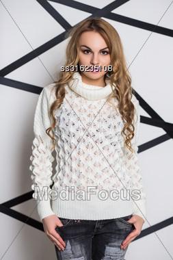 Portrait Of Beautiful Woman Wearing White Knitted Sweater Stock Photo