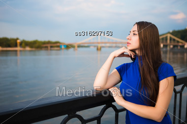 Portrait Of Beautiful Young Brunette Posing Near The River Stock Photo