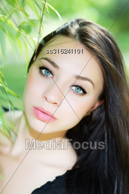Portrait Of Beautiful Young Caucasian Woman Posing Outdoors Stock Photo