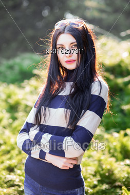 Portrait Of Beautiful Young Woman Posing Outdoors Stock Photo