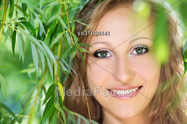 Portrait Of Blond Young Woman Posing Outdoors Stock Photo
