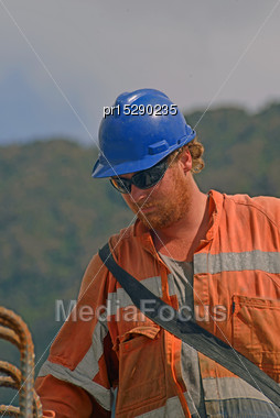Portrait Of Builder At Work On A Concrete Bridge Over A Small River In Westland, New Zealand Stock Photo