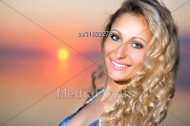 Portrait Of Cheerful Blond Woman At The Sunset Stock Photo
