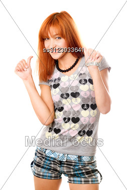 Portrait Of Cheerful Red-haired Girl In A T-shirt And Shorts Stock Photo