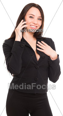 Portrait Of Cheerful Young Brunette Talking On The Phone. Isolated On White Stock Photo