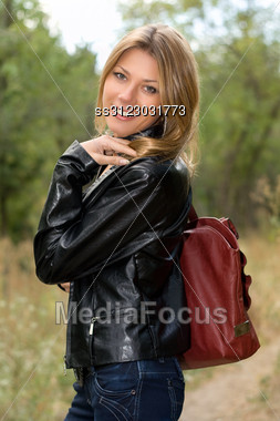 Portrait Of A Cheerful Young Woman In The Forest Stock Photo