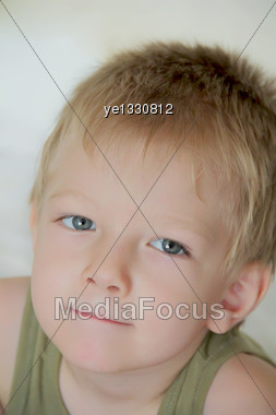 Portrait Of Cute Boy With Blue Eyes Stock Photo