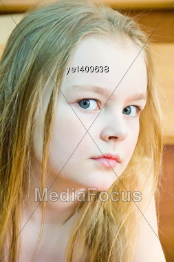 Portrait Of Cute Girl With Blond Hair Stock Photo