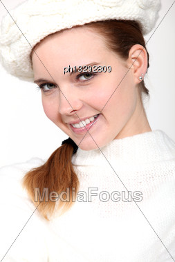 Portrait Of Delightful Woman With Woolen Cap And Jumper Stock Photo
