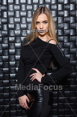 Portrait Of Elegant Young Woman Wearing Black Clothes Posing In Studio Stock Photo