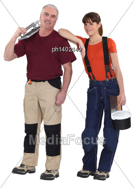 Portrait Of Experienced Craftsman And Female Apprentice Stock Photo