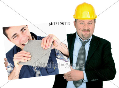 Portrait Of Foreman Holding Picture Of Young Tiler Stock Photo