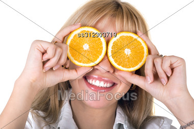 Portrait Of The Funny Smiling Girl With Oranges. Stock Photo