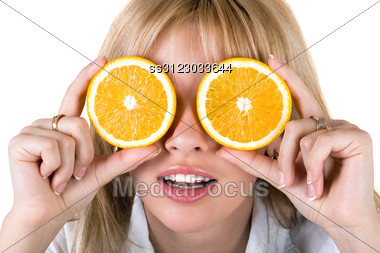 Portrait Of The Funny Young Woman With Oranges. Stock Photo