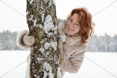 Portrait Of Happy Red-haired Woman In Winters Day. Stock Photo