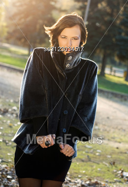 Portrait Of A Hot Young Woman In Autumn Park Stock Photo