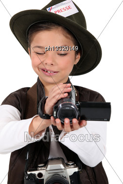 Portrait Of A Little Girl Dressed As A Photographer Stock Photo