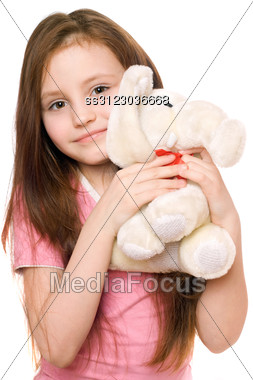 Portrait Of Little Girl With A Teddy Elephant. Stock Photo