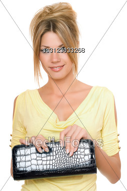 Portrait Of Lovely Young Blonde With A Handbag In Hands Stock Photo