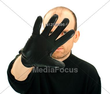 Portrait Of A Man Hiding His Face Stock Photo