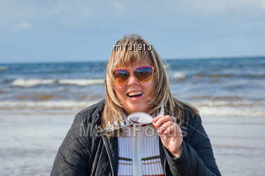 Portrait Of Mature Chubby Woman Relaxing At The Baltic Sea In Autumn Day ...