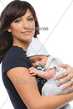 Portrait Of Mother Holding Newborn Baby Son In Her Arms Stock Photo