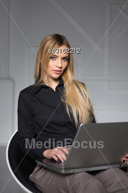 Portrait Of Nice Blond Woman Posing With Laptop Stock Photo