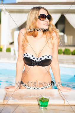Portrait Of A Nice Blond Woman Posing In The Swimming Pool Stock Photo
