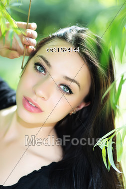 Portrait Of Nice Young Woman Posing Outdoors Stock Photo