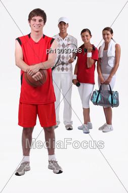 Portrait Of 4 Sporty People Stock Photo